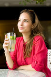 Young brunette with cool refreshment. Portrait of a young brunette with cool refreshment Stock Photos