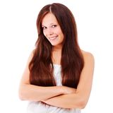 Young brunette with crossed arms Royalty Free Stock Image