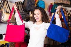 Young brunette customer purchasing new hand bag in store Stock Photos
