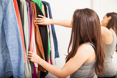 Young brunette deciding what to wear Stock Photos