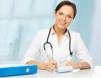 Young brunette doctor woman Stock Images