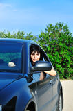 Young brunette driving car Royalty Free Stock Photography