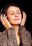 Young brunette with ear-phones Stock Photo