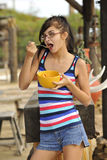Young Brunette Eating Healthy Snack Royalty Free Stock Images