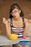Young Brunette Eating Healthy Snack Royalty Free Stock Photo