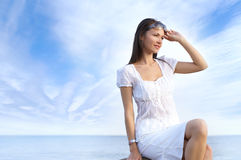 A young brunette is enjoying the good weather Royalty Free Stock Photo