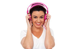 Young brunette enjoying music Royalty Free Stock Photography