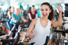 Young brunette in exercise bikes class Stock Photos