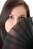 Young brunette with fan portrait. Royalty Free Stock Image