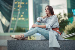Young brunette female in city royalty free stock photography