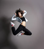 A young brunette female dancer in sporty clothes Stock Images