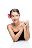 Young brunette female with gerbrera flower Royalty Free Stock Image