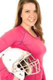 Young brunette female model holding American football helmet Royalty Free Stock Photos