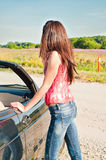 Young brunette female standing near car Stock Image