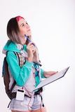 Young brunette female student standing and listening to music from your device. Royalty Free Stock Images