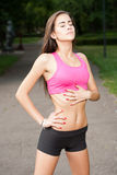 Young brunette fitness girl. Royalty Free Stock Photography