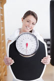 Young brunette fitness woman with scale Stock Images