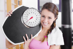 Young brunette fitness woman with scale Royalty Free Stock Images