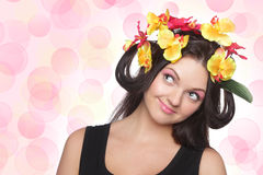 Young brunette with flowers on head Royalty Free Stock Image