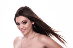 Young brunette with fluttering hair Stock Photography