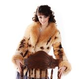 Young brunette in a fur coat Royalty Free Stock Images
