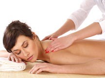 A young brunette is getting spa treatment Royalty Free Stock Photo
