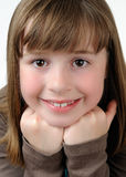 Young brunette girl with bangs. Closeup of young caucasian brunette girl with bangs isolated against white background royalty free stock photos