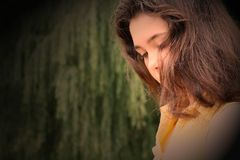 Young brunette Girl in deep thought Stock Photo