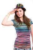 Young brunette girl doing funny salute. Stock Photos