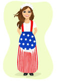 Young brunette girl dressed in a flag and hat from Uncle Sam Royalty Free Stock Photography