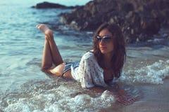 Young brunette girl enjoying and sunbathing on the Royalty Free Stock Photography