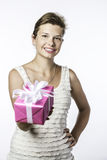 Young brunette girl with gift Royalty Free Stock Image