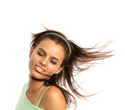 Young brunette girl with a hairdress in movement Royalty Free Stock Photos