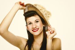 Young brunette girl in hat retro styling Royalty Free Stock Image