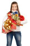 Young brunette girl holding gifts Royalty Free Stock Photography