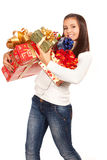 Young brunette girl holding gifts Royalty Free Stock Image