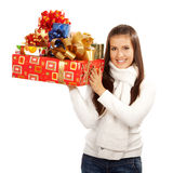 Young brunette girl holding gifts Stock Photo