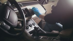 Free Young Brunette Girl In Gloves Is Washing With Brush A Car Dashboard And Steering Wheel Royalty Free Stock Photo - 109920905
