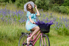 A young brunette girl lupine meadow stock photography