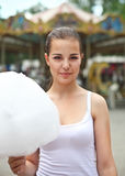 Young brunette girl near the carousel Royalty Free Stock Image