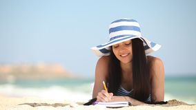 Young brunette girl with note and pencil stock video footage