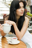 Young brunette girl outdoors Stock Image