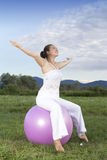 Young brunette girl performing yoga Royalty Free Stock Image