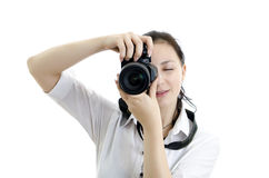 Young brunette girl with photocamera Royalty Free Stock Photos