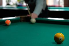 Young brunette girl playing snooker royalty free stock photography