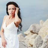Young brunette girl at seaside Royalty Free Stock Image