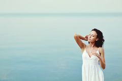 Young brunette girl at seaside Stock Photos
