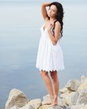 Young brunette girl at seaside Royalty Free Stock Photo
