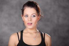 Young brunette girl show tongue Royalty Free Stock Photos