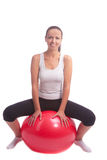 Young brunette girl sitting on fitball Royalty Free Stock Photo
